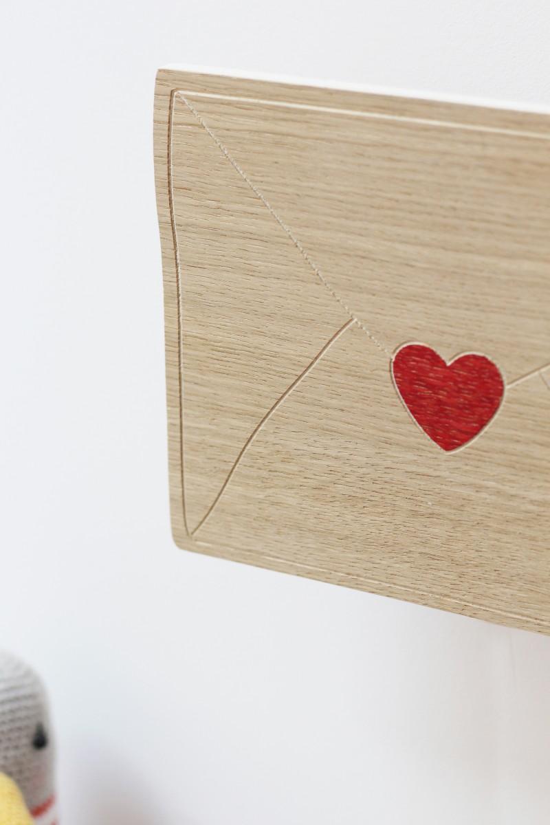 Boite à musique coeur visage en bois
