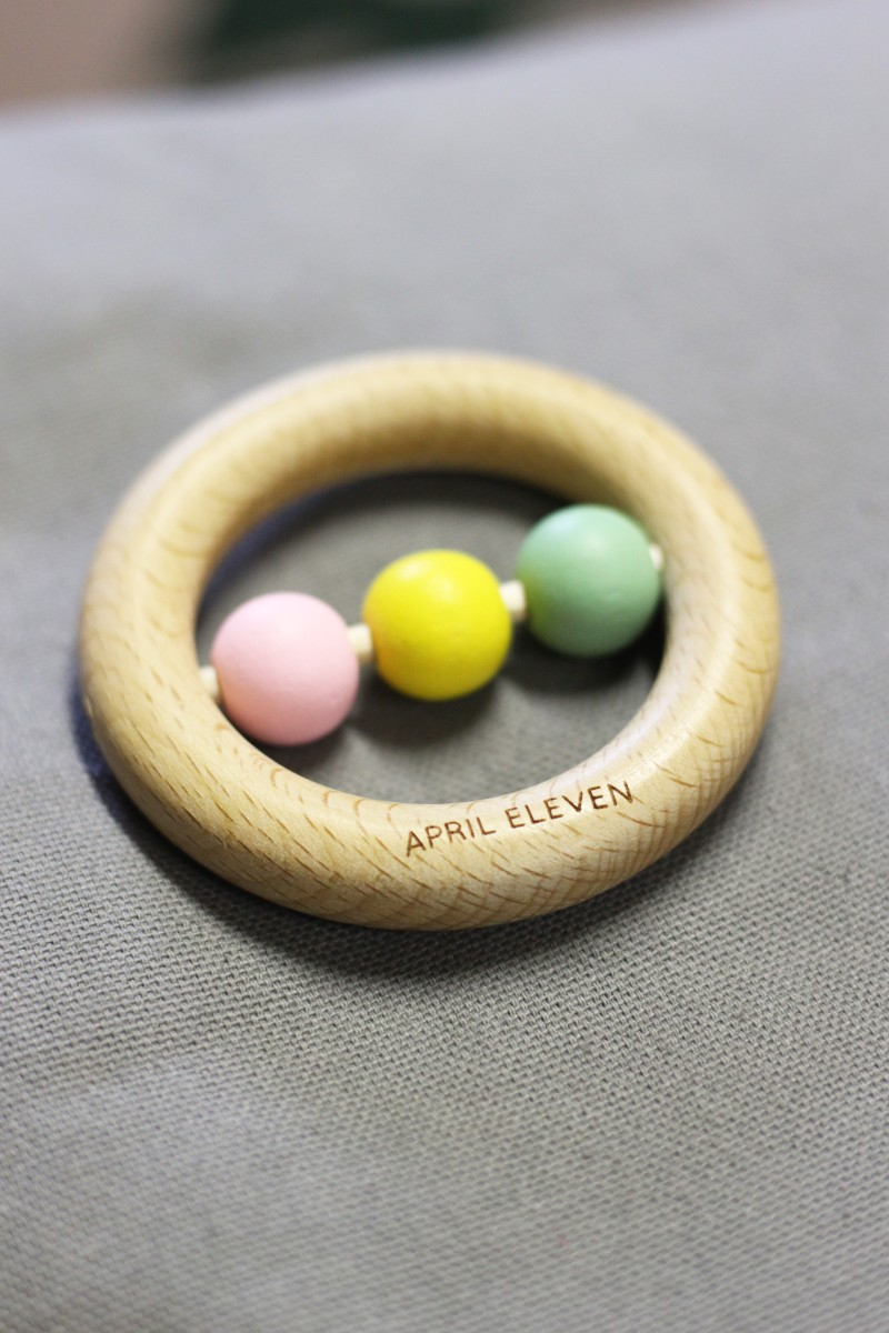 April Eleven wooden rattle