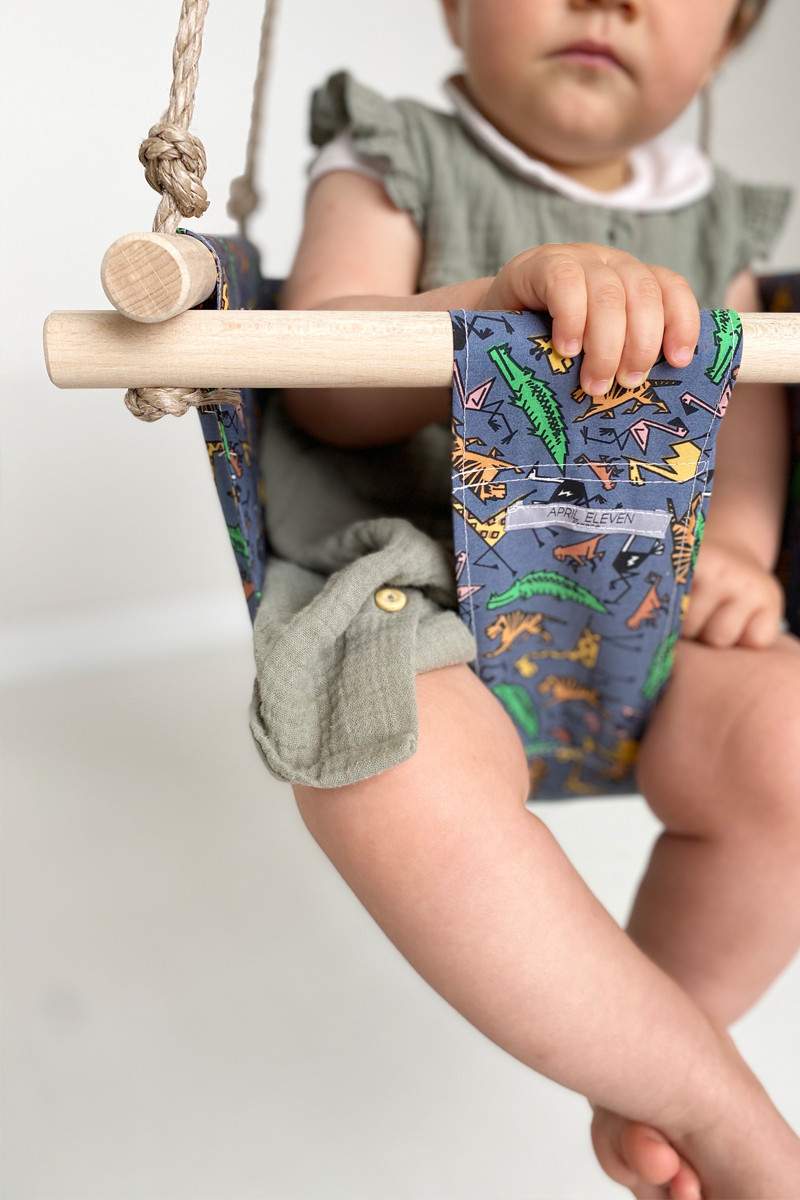 Baby swing in blue fabric